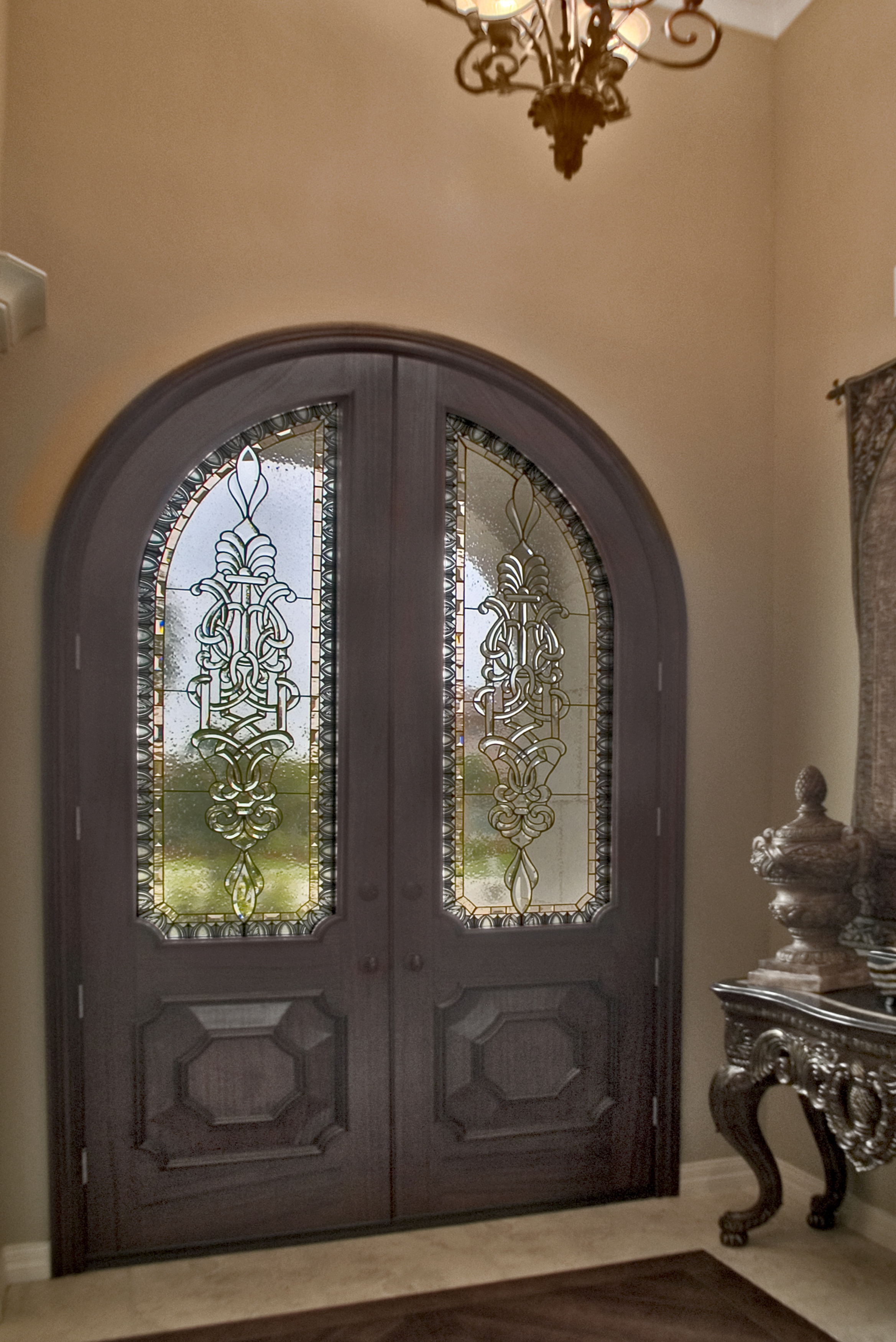 9 foot oversized wood doors with custom 6 foot tall beveled glass inserts by Preston Studios