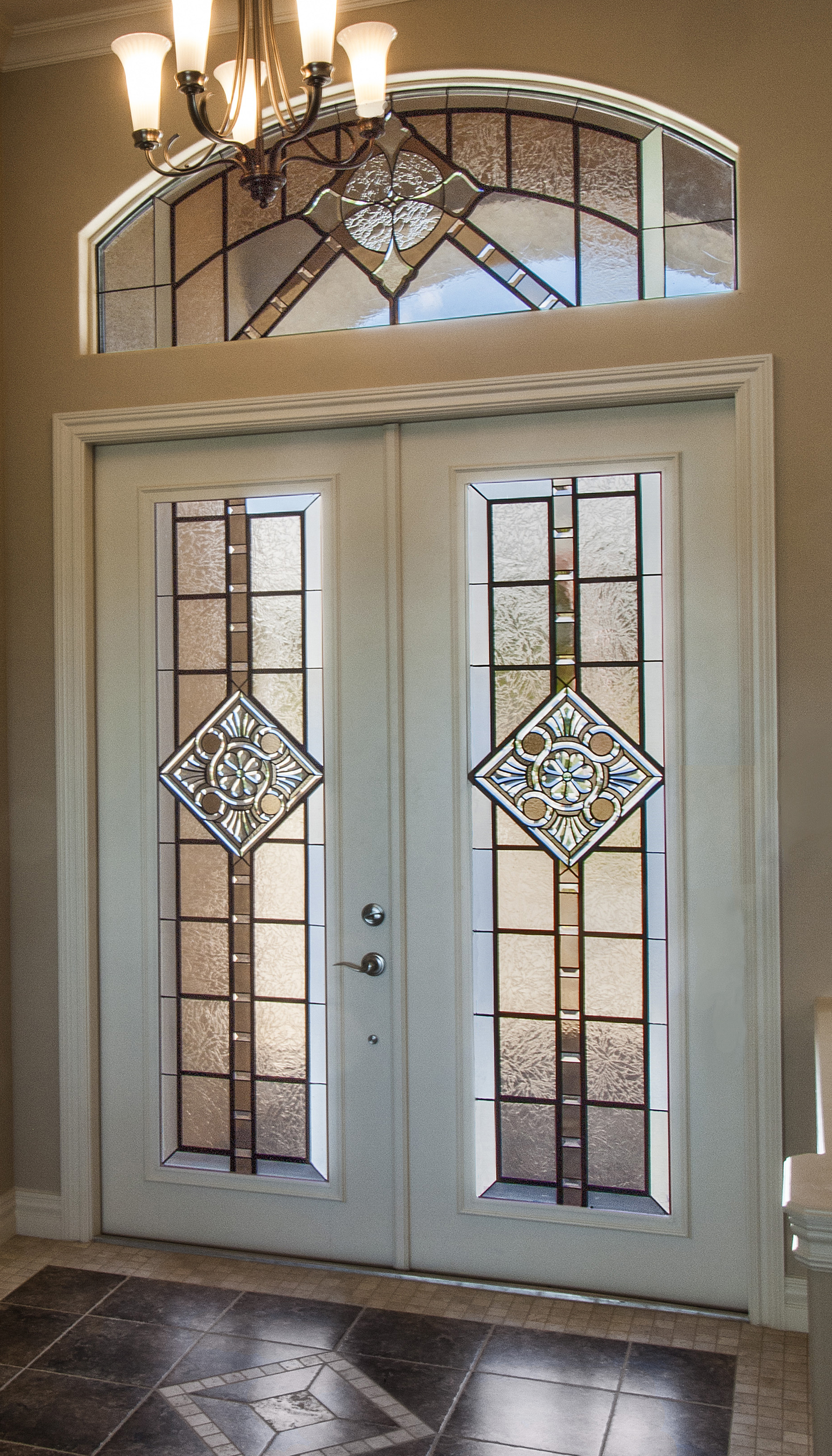 Transitional modern approach to entrance design by Preston Studios featuring faux wrought iron