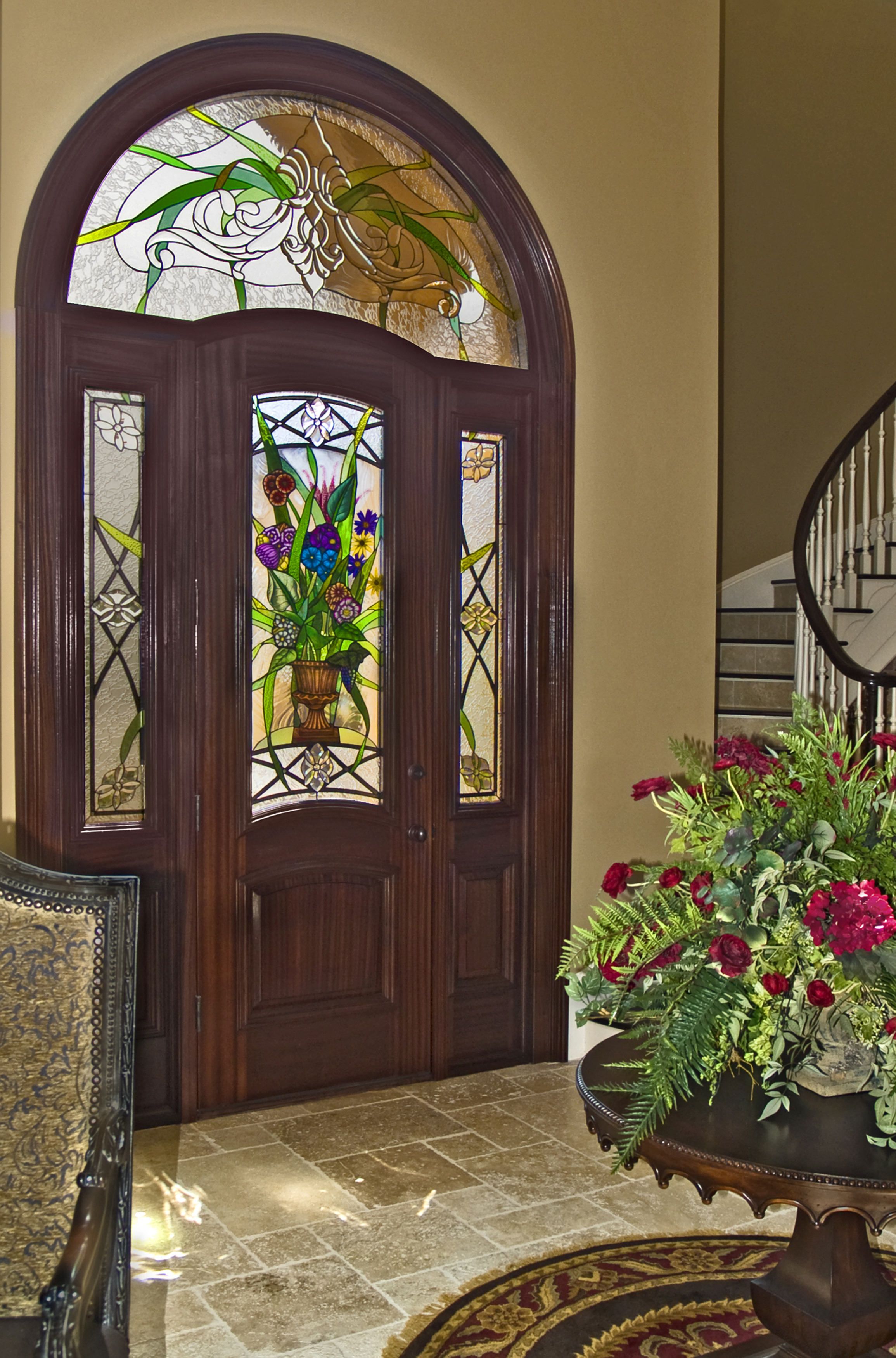 Custom Italianate entrance design featuring hand painted and fired elements