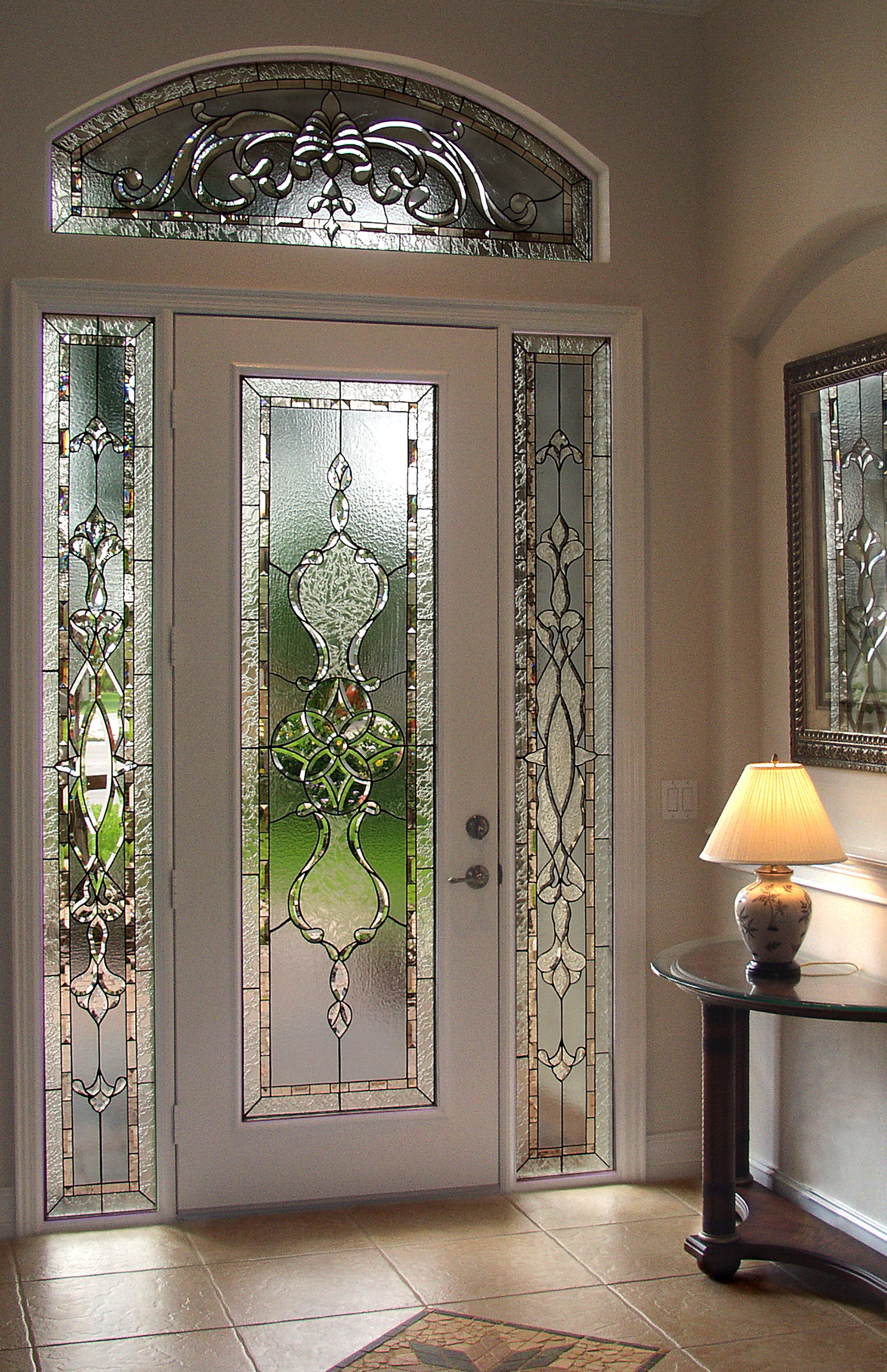 Custom Italianate design in beveled glass, with tones of gray and peach