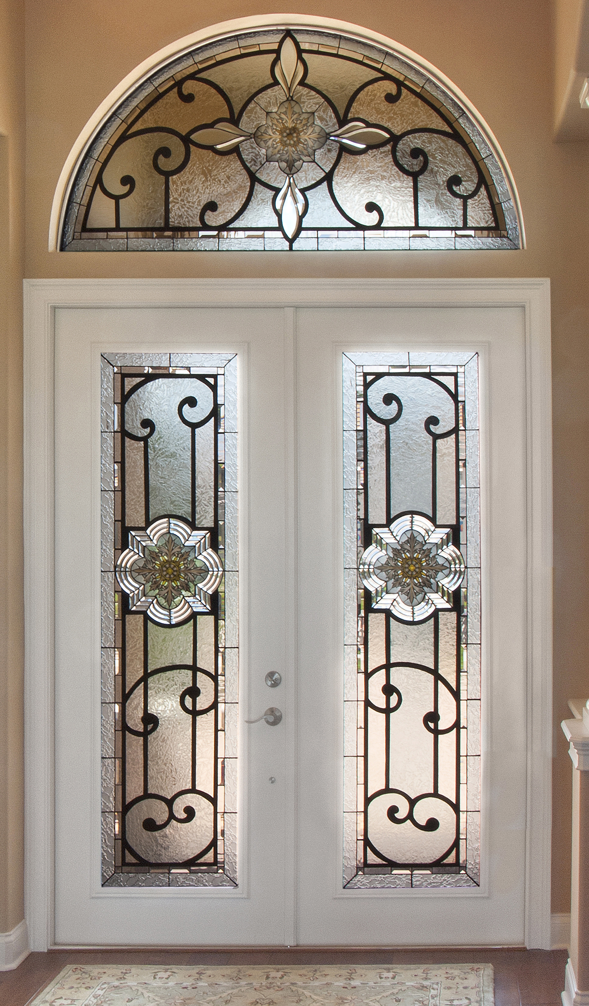 Distinctive custom stained glass medallions make this entrance unique
