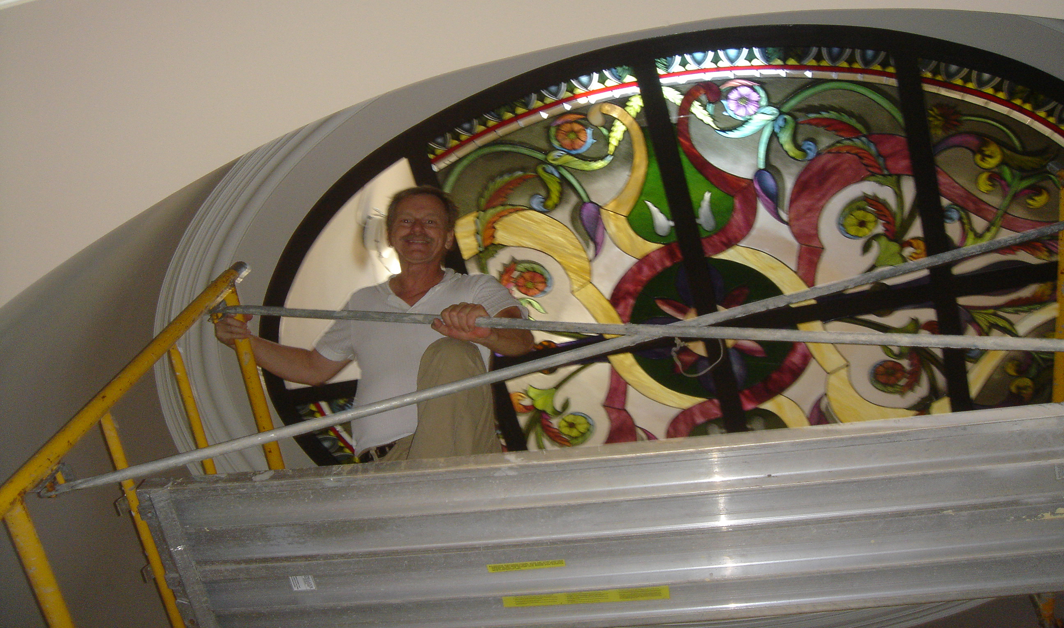 John Emery of Preston Studios installing the Love residence ceiling glass.
