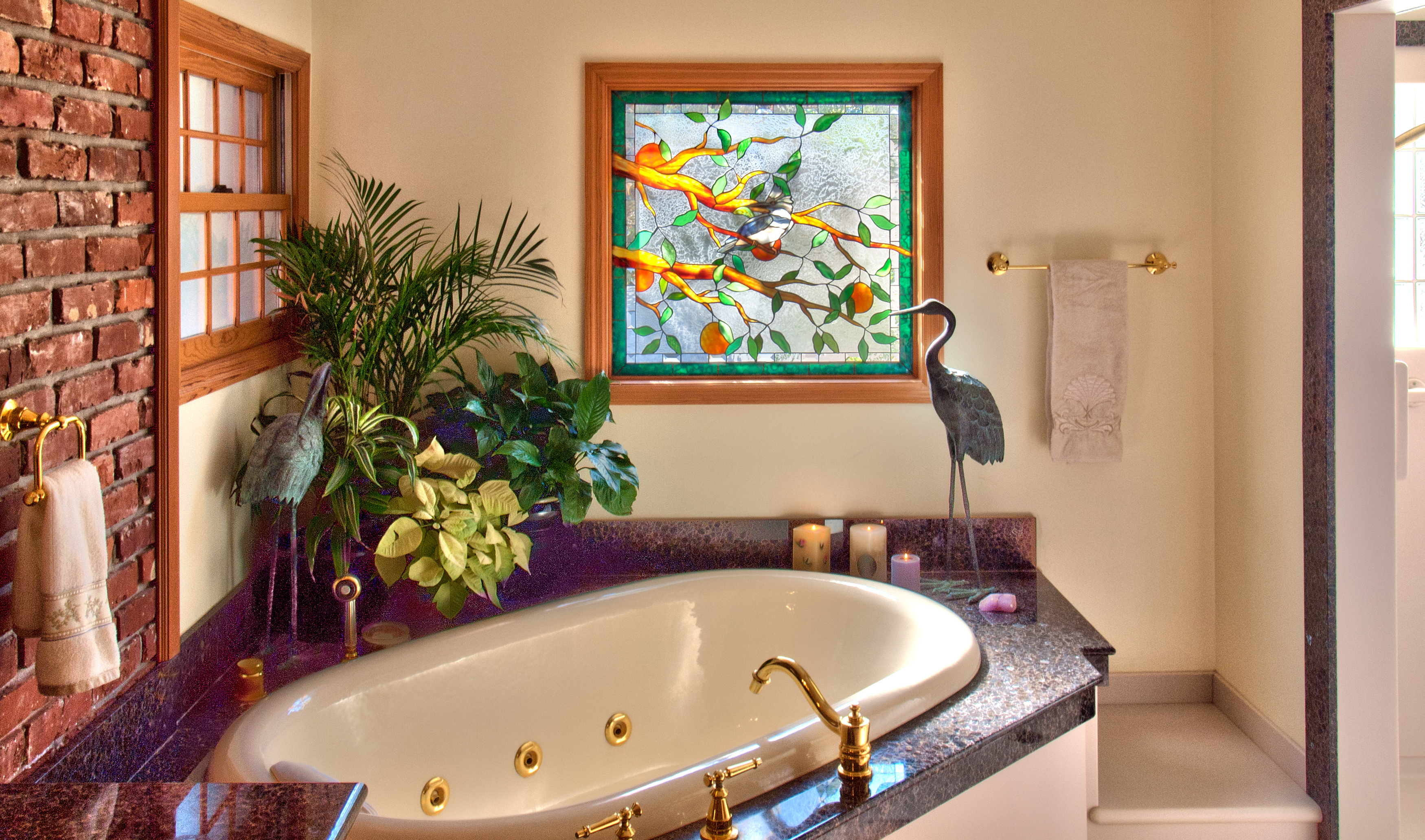 A unique commissioned bath window by PRESTON STUDIOS